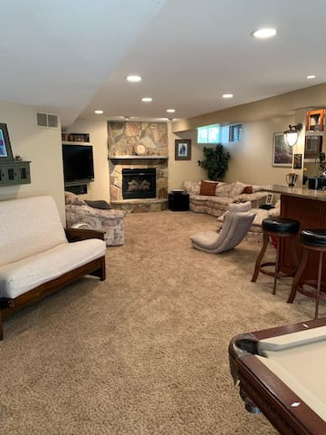 Plenty of seating in front of the large flat screen TV and gas fireplace