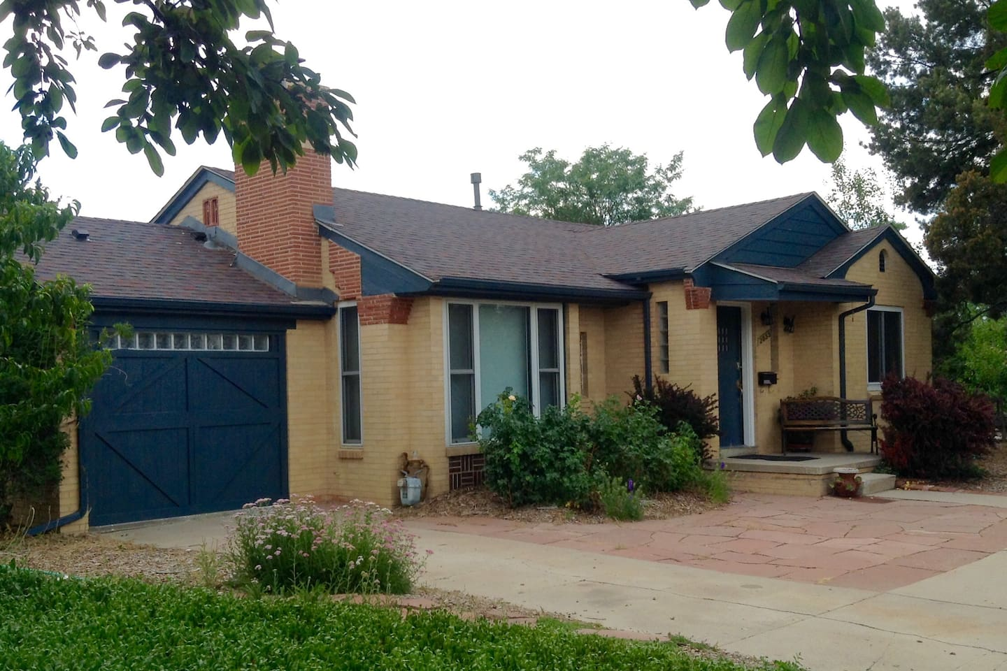 The house is set back from the street and completely surrounded by gardens on four city lots.