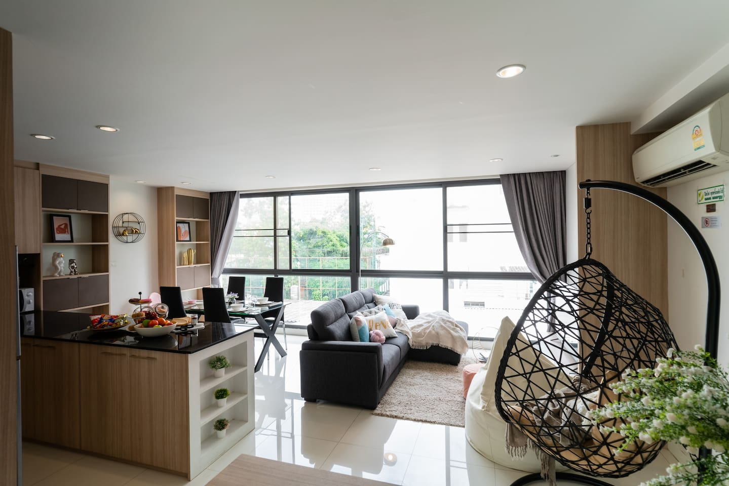Spacious living room with full height window, lot of natural light.  Full kitchen appliance, (electric strove,  coffee capsule, microwave, refrigerator, kettle) perfect for frient and family  Sofa can turn into sofa bed for