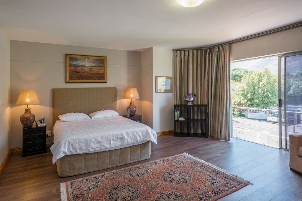 Spacious main en suite bedroom with breathtaking views of the Bay