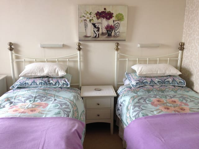 Twin beds in a light airy room