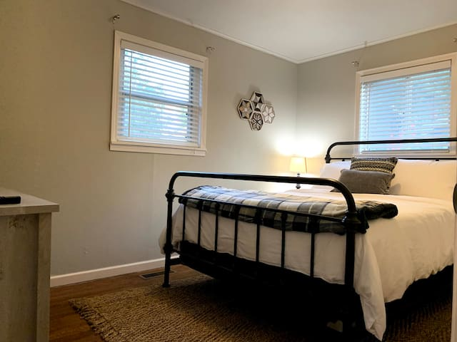 Queen size bed with memory foam mattress and large screen TV