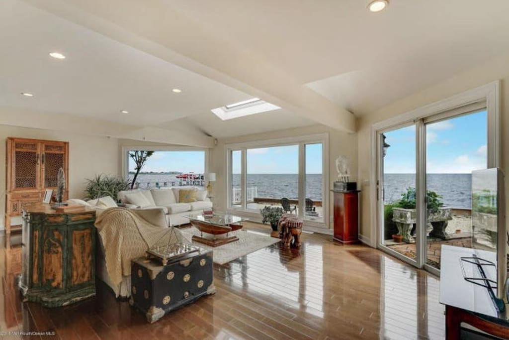 Family Room Over Looking the Bay with Private Backyard.
