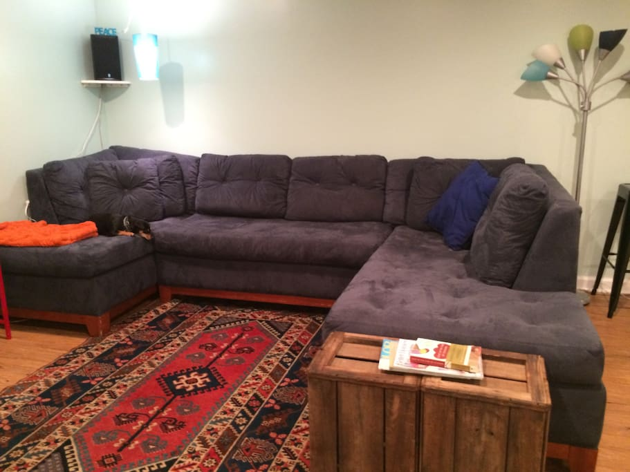 Comfy sectional couch and tv with Hulu and Netflix.