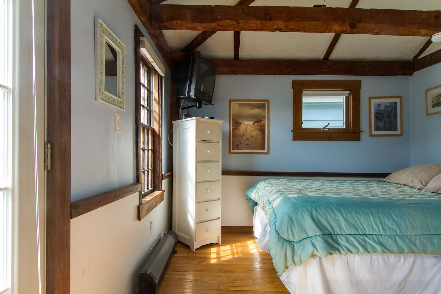 Your private bedroom is accessible from a separate entry from outside or inside from the living room. Bedroom includes a very comfortable queen bed, a closet With provided hangers, lots of natural light, and cable TV.