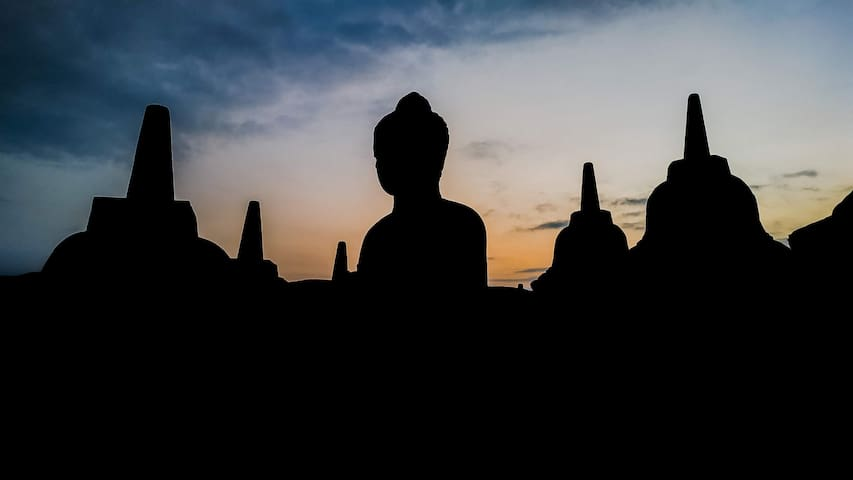 Buddha statue at Borobudur Sunrise It's a few minutes walk to the entrance gate from Genthong Homestay.