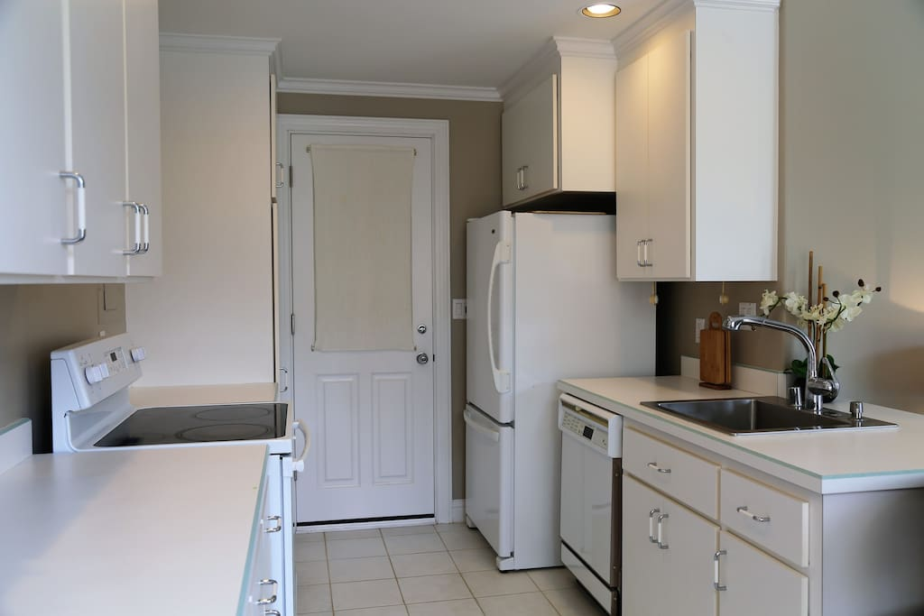 Full size kitchen with everything you need: stove, refrigerator and dishwasher