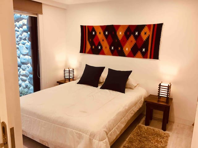 Super cozy queen size bed with access to private patio