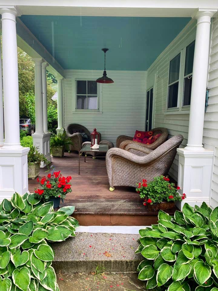 Side porch for relaxing after a day exploring or at the beach