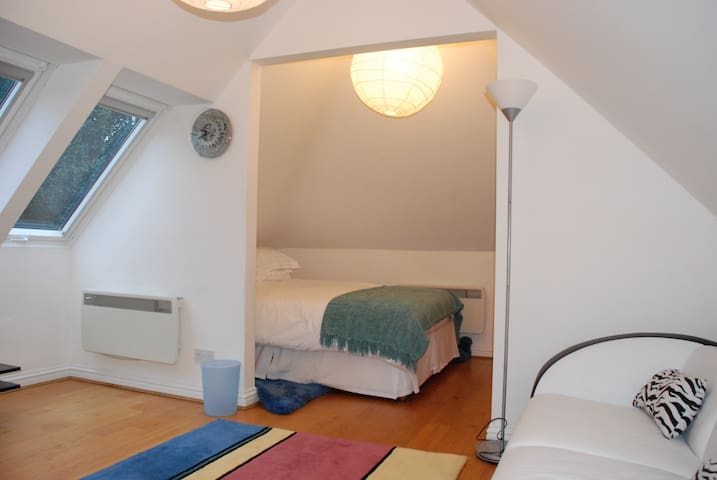 Sleeping area with double bed, drawers and hanging rail