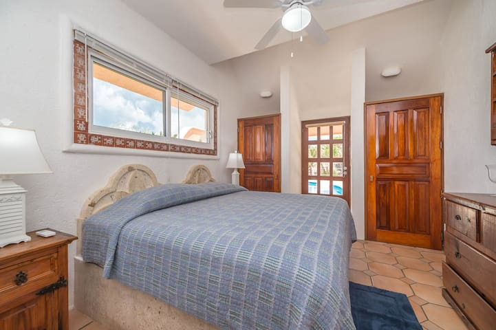 Lower king bedroom that leads to the pool deck.  This bedroom accesses the detached main level bathroom with a shower.