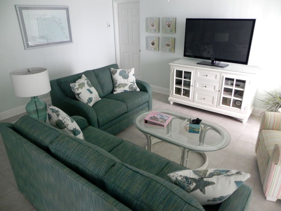 Living Area with Samsung HDTV, Queen Size Sleeper Sofa,Floor to Ceiling Ocean View and Balcony Access.