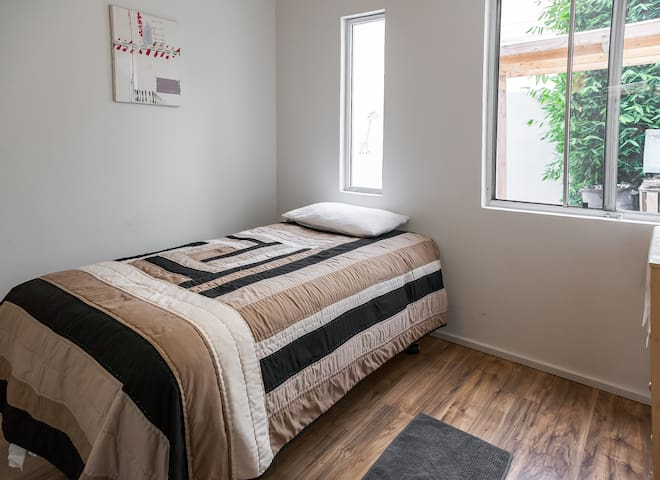 The bed in this room was changed for a queen size bed and blinds were put on the windows.