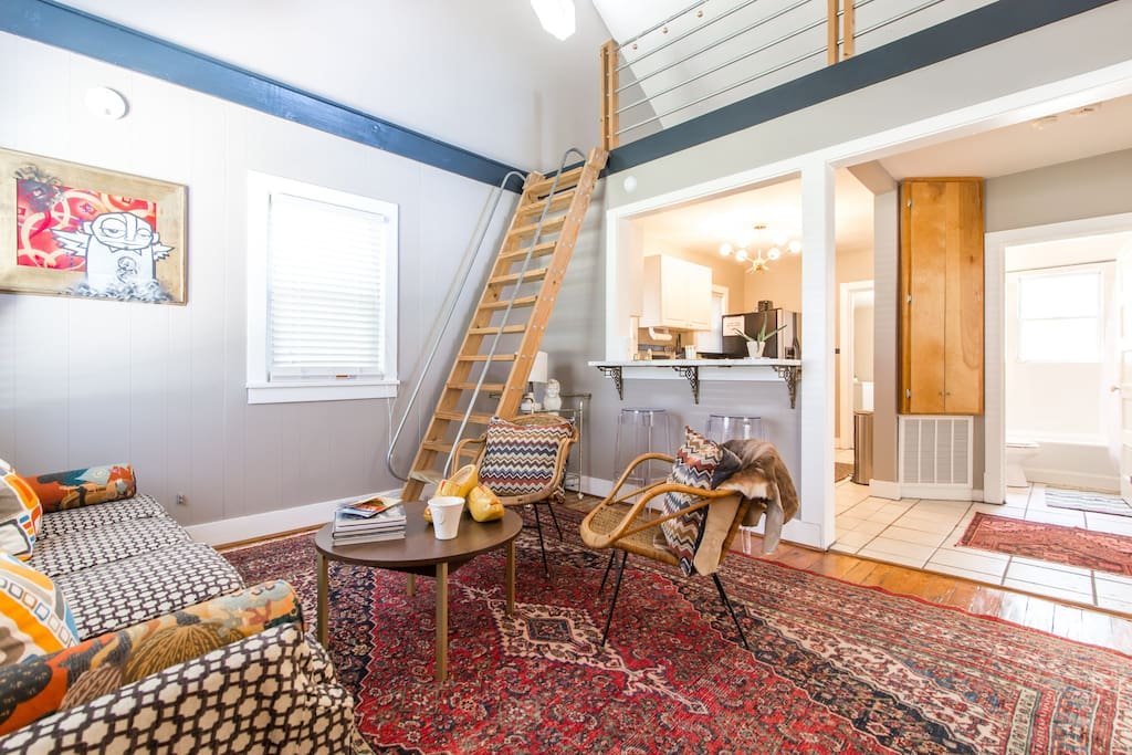 Welcome to our special Mod Cape Cod - in the heart of East Nashville! Living room, looking up into the bright loft (which holds a cozy nook/office space and houses a deluxe full-sized air mattress for extra guests).
