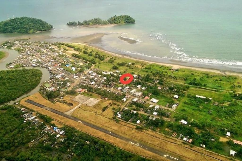 Photo of Nuqui. Red circle, location of the house