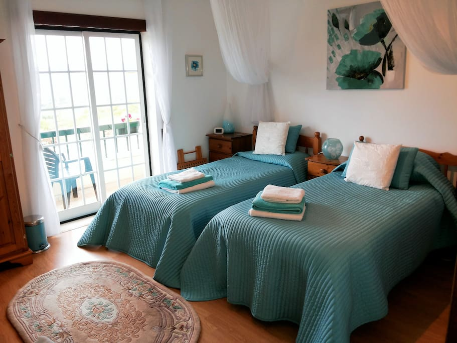 Twin Bedroom with ensuite shower room. Balcony enjoying spectacular views and beautiful sunsets. Tea/coffee making facilities,refrigerator with welcome pack of wine,beer,juices,milk and water. Air conditioning and central heating. TV with European channels. Free WiFi.