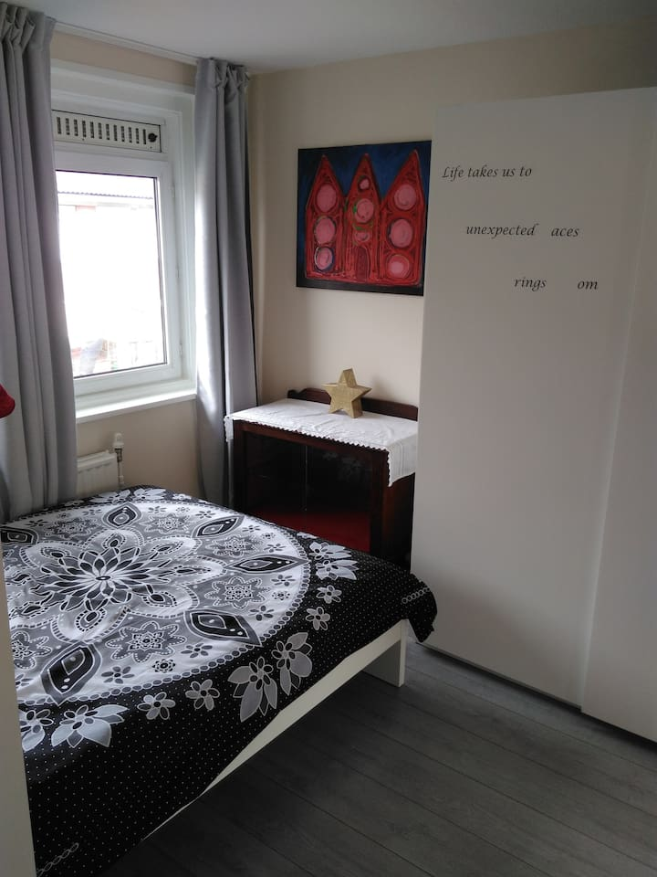 Comfy double bed, night table, cupboard and wardrobe