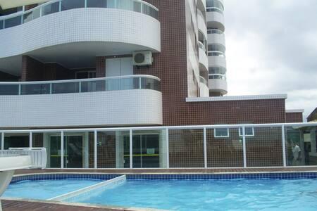 Apartamento de frente com Piscina e churrasqueira - Praia Grande - 公寓