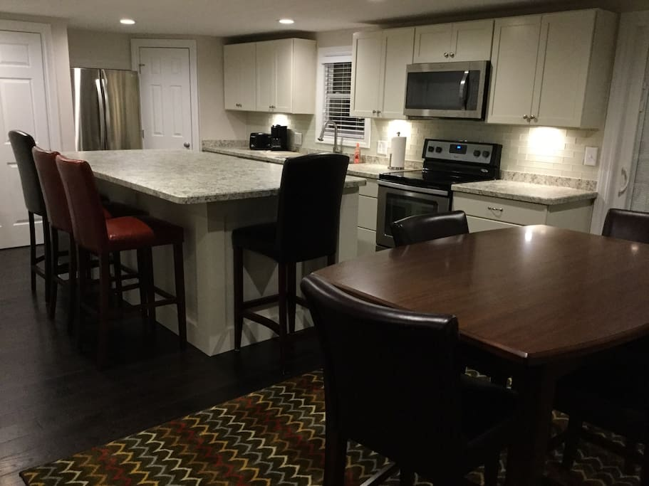 Huge kitchen island and high top table, perfect for eating, games, cooking or just relaxing!!