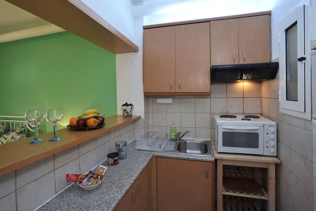 Convenient kitchenette with spacious fridge and storage space