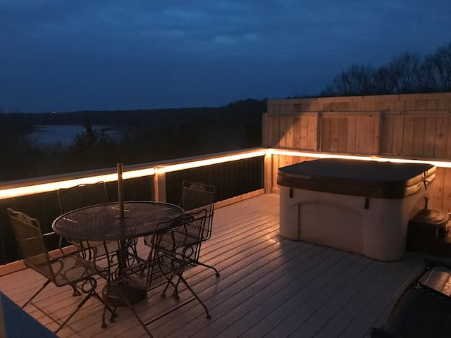 New large rear deck with private hot tub.