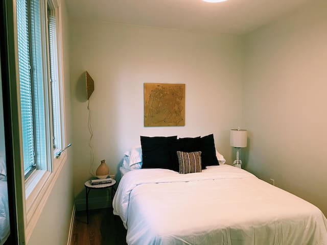 Modern third bedroom with double bed