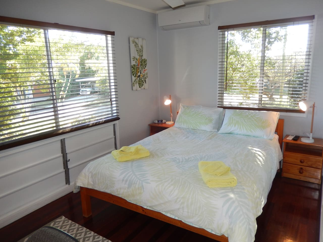 Comfy Queen sized bed in a breezy bedroom with airconditioning if required