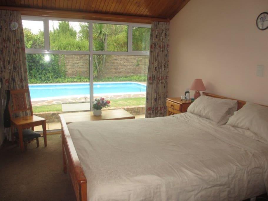 Half of main bedroom with Queen bed