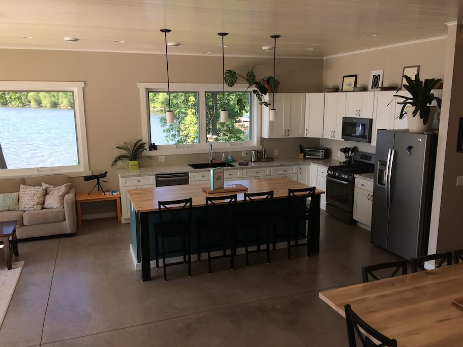 Open concept kitchen, dining and living space