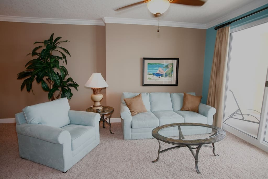 Sunny living room with balcony access and pull out sleeper sofa!
