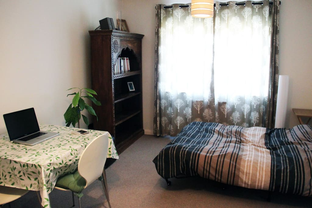 Very spacious room with a comfortable sofa bed, dinner table and large vintage shelving unit for your use