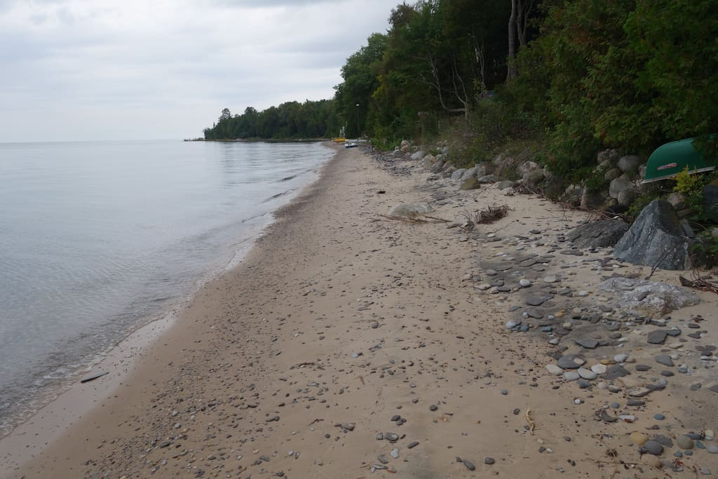 Mainly sand beach with lots of Petoskey and Charlevoix stones