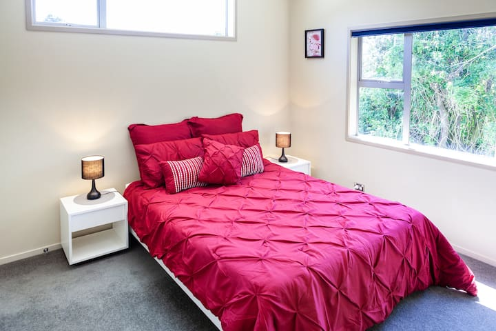 Queen bedroom upstairs, lovely north facing aspect and garden views.