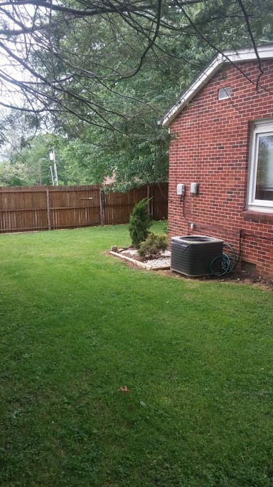 A privacy fence surrounds 3 parts of the yard.