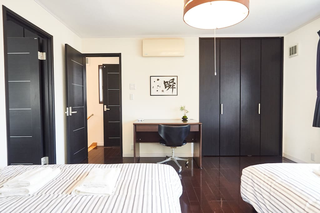 The main sleeping area can accommodate up to four people in two comfortable double beds
