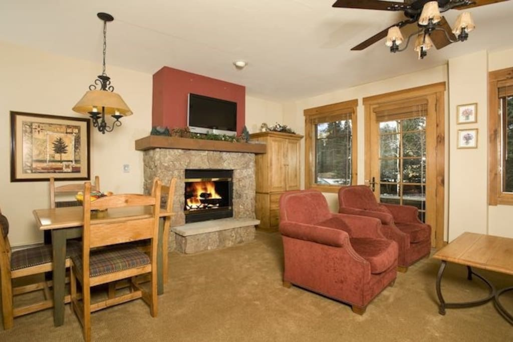 The living area is spacious and cozy, complete with fireplace.