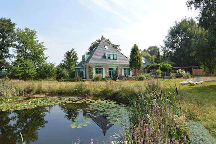 Lavishly appointed group accommodation in a quiet location with distant views and a swimming pond
