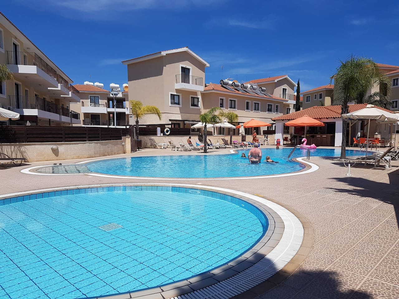 Crystal clear swimming pool, sunbeds and umbrellas are provided free of charge