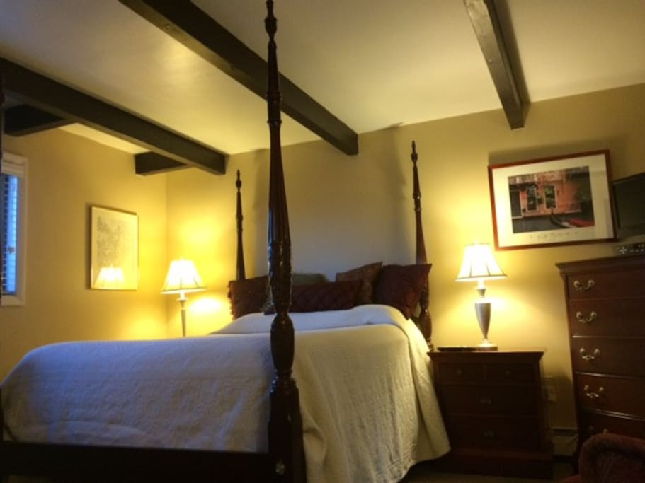 Comfortable Queen four-poster bed anchors the room