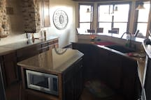 chefs kitchen plenty of room to cook, open to dining and living rooms looking to lake
