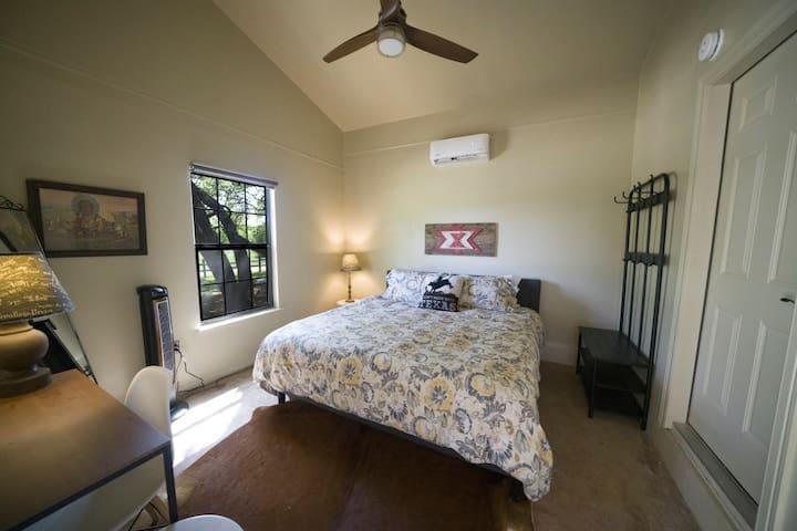corner queen room attached to double twin bunk room with interior door