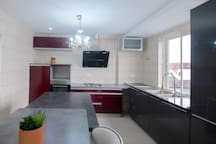 Fully equipped kitchen with and island and modern appliances