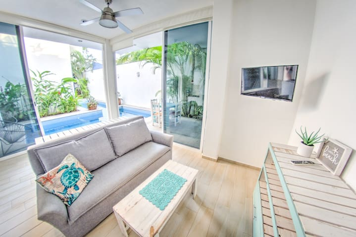 Living room that opens up to your private pool area. Comes with smart TV and a comfy sofa bed.
