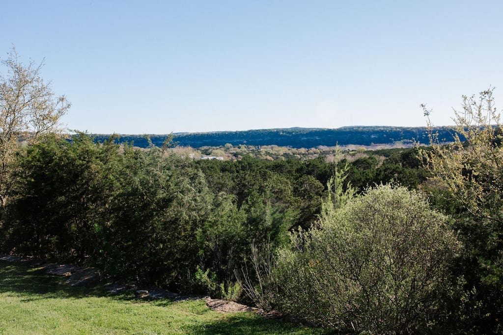 View from main house deck over looking Hill Country canyon. Request private yoga instruction on the deck. Additional fees apply.