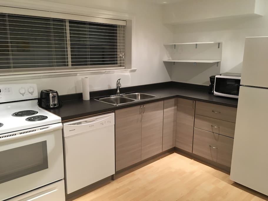 Brand new kitchen with full sized fridge, oven, and dishwasher. Stocked with everything you may need for your stay plus salt, pepper, oil, and enough coffee/tea for your first few nights.