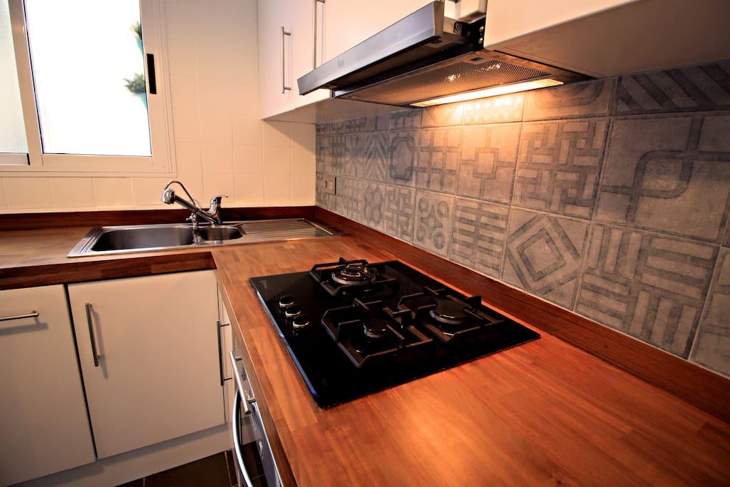 Kitchen with vintage mosaics -XIX century- and iroko wood.