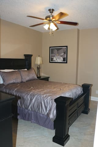 Master bathroom Edit caption    Guest bedroom with queen size bed