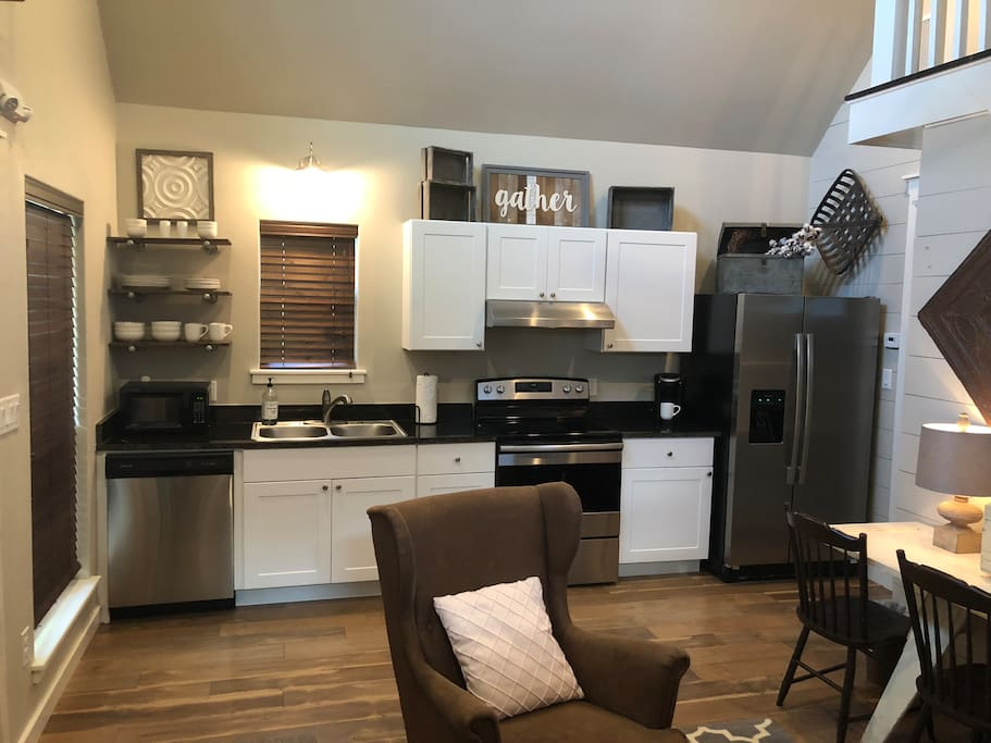 Our beautiful kitchen is equipped with a microwave, dishwasher, stove, refrigerator, Keurig, washer, dryer and gas grill! We provide you with basic kitchen utensils, dinner ware and flat ware! Perfect for making your favorite meal and memories!