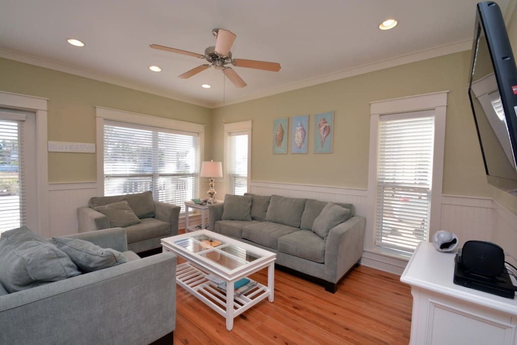 Just inside the front door is the main living area, featuring plush furnishings and a flatscreen tv!