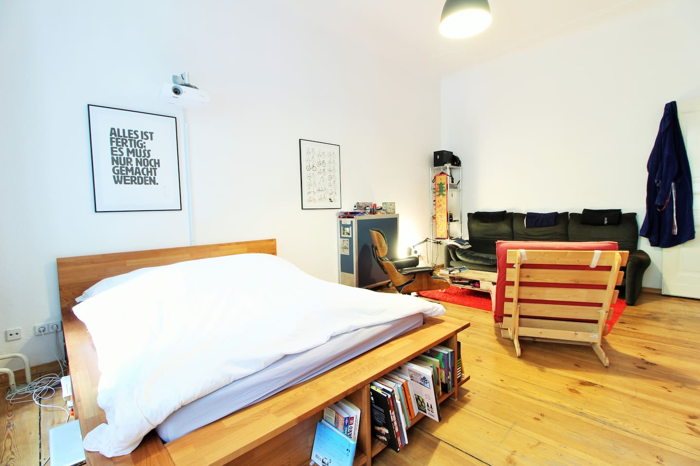 The living area is very spacious and has nice wooden floors.